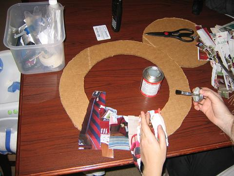 Cutting out wreath and using strips of catalog
